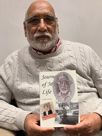 Harry Sagoo with his book